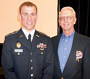 Scholarship recipient Cadet Jeremy Dettmer, left, and Ken Iwan.