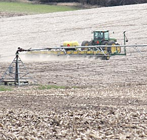 Tractor and planter operating south of Albion Monday.