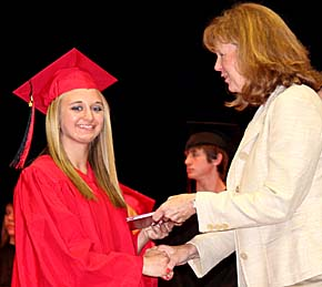 Boone Central graduate Rachel Lee receives her diploma from School Boards President Karen Kayton.
