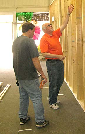 Dan Willis of Heartland Jewelry discusses construction at the former Moyer's building with his contractor.