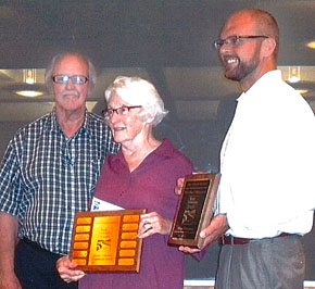 Harry and Bernie Cunningham (l.-r.) accept awardsfrom Keep Nebraska Beautiful Chairman Matt Hazen.