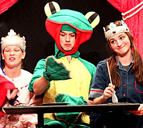 The Frog (Sam Baue) is flanked by Princess Proper (Grace Woebbecke) and Princess Peppy (Kyley Sorell) in this scene from The Frog Prince.