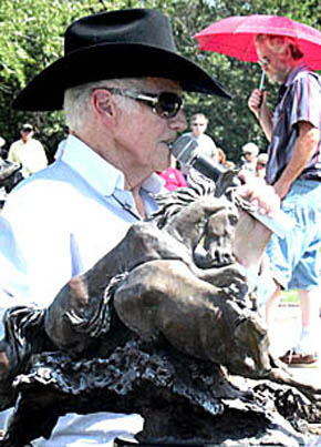 Herb Mignery describes one of the sculptures in the Bartlett sculpture garden.