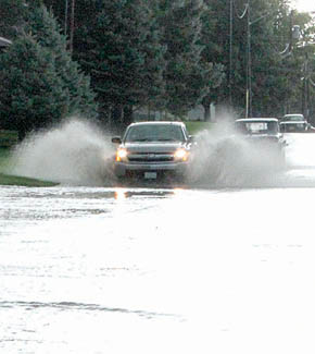 A vehicle plows through deep water on east Fairview Street after the Aug. 1 storm.