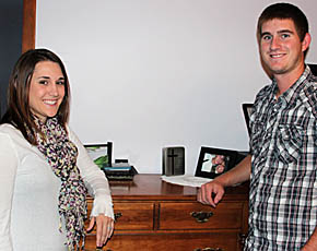 Theresa and Brian Tisthammer with the chest of drawers where they found $330 in cash.