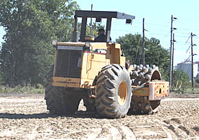 Dirt packer working at new motel site.