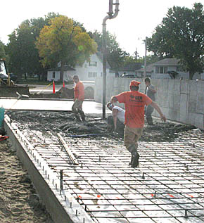 Pouring the floor for new building at Helena, Petersburg.