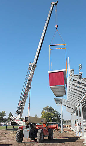 Press box is lifted into place at Boone Central football field.