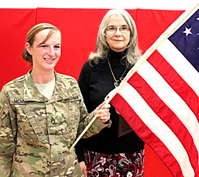 Staff Sgt. Tana McMillan and Boone Central teacher Cheri Blecher with special flag.