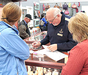 Dan Willis of Heartland Jewelry waits on customers during the grand opening last Friday.