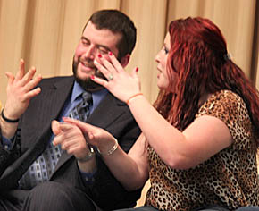 Drew Schafer, left, gets help from Missy Neidhardt in counting his fingers while under hypnosis at the Doug MacCraw show.