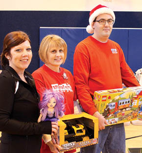 Toys for Tots Committee members holding some of the toys given are (l. to r.) Melinda Johnson, Renita Karmann and Mike Mapel.