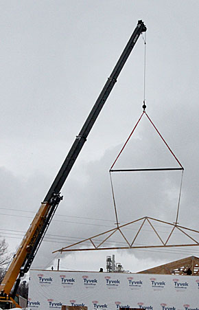 Crane raises rafters for the new Cardinal Inn motel in Albion.