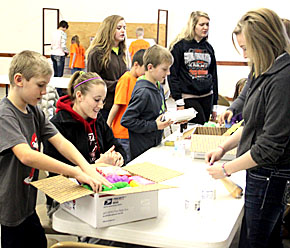 "BYC students make up ""care packages"" to send to troops."