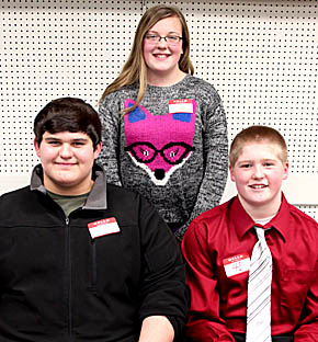 TOP THREE SPELLERS in the Boone County Contest were (back) McKenna Book, first place; Calvin Musil, l., second, and Jessie Sullivan, r., third.