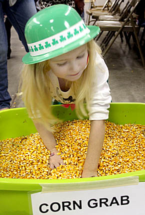 Digging for a prize at the Corn Grab booth.