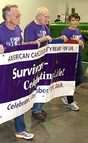 Banner carriers lead the way during the Survivors Lap of the 2014 Relay for Life.