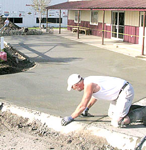 Randy Porter finishes new concrete at the Boone County Fairgrounds.