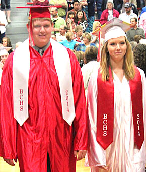 Alex Hayes and Hannah Howell march up the aisle for commencement.