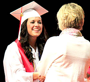 Boone Central grad Bridget Krings accepts her diploma from School Board member Patti Meyer.