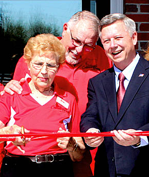 Participans in the Cardinal Inn ribbon cutting Saturday included, l. to r., CEO Jackie Christo, co-owner Randy Christo and Gov. Dave Heineman.