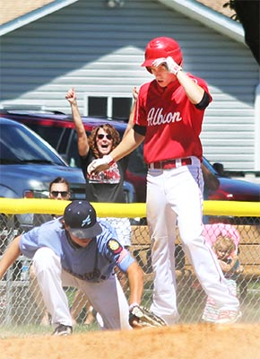 Pierce Koch is safe at third as his mother, Angie, celebrates in the background. Photo by Karley Zoucha