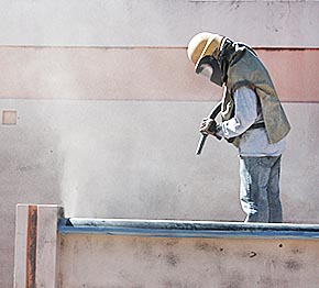 Sandblasting of fountain in Albion's downtown mini-park.