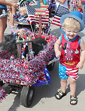 Kiddie Parade first place winner Xander Wright and his dog, Gidget.