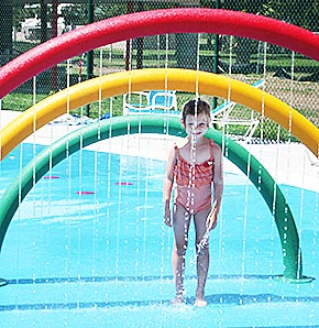 The splash pad feature is popular with younger children at the new Albion Family Aquatic Center.