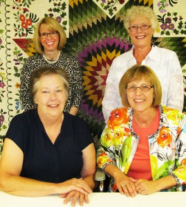PRESENTERS -- Those presenting segments of the 'Quilts of Local Color' program in Albion Saturday were (back, l.-r.) Jeanine Peeks and Nancy Shavlik; and (front) Janet Person and Carol Kusek.