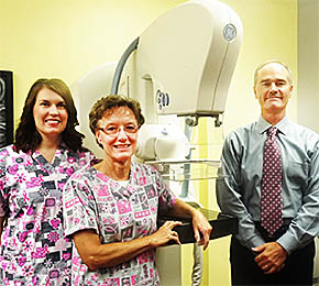 Boone County Health Center staff members (l.-r.) Beth Sonderup, RT(R); Carol Seaman, RT(R)(M), and Robert Faulk, MD, with new mammography equipment.