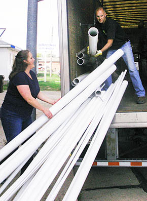 Betsy Harris helps unload the first new merchandise arriving at Main Street Hardware.