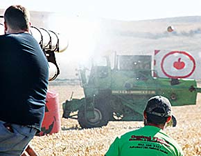 A team in the air cannon accuracty competition fires a shot that just missed the target mounted to a combine.