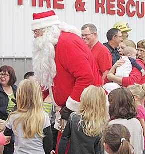 Santa's helper Sterling Morton arrives at the Petersburg Fire Station to visit with local children on Dec. 13.