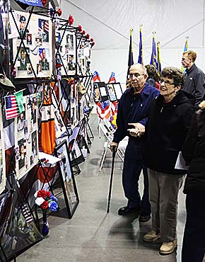"Albion residents Dale and Betty Bowman view the ""Remember Our Fallen"" photo exhibit."