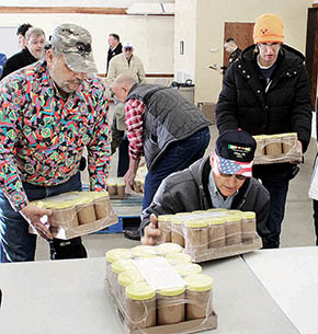 Volunteers unload peanut butter during preparations for the Mobile Food Pantry last Saturday.