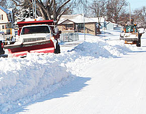 City equipment cleans up long windrows of snow after last weekend's storm.