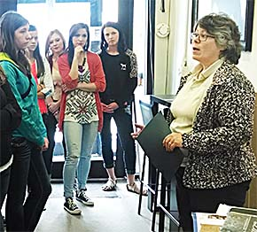 Jennifer Leifeld visits with students in her furniture store during Business and Industry Day.