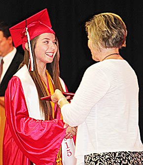 Brianna Brugman, named Outstanding Student at Boone Central for the 2014-15 school year, accepts her diploma from School Board member Patti Meyer.