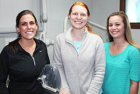 Joining Dr. Kate Kusek-Johnson (center) at Albion Dental Clinic are Betsy Niewohner, l., and Chelsey Polsey, r.
