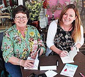 Local authors Mary Avidano, l., and Jenni DeWitt, were featured at a book signing during May Day Madness.