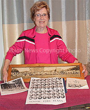Dorothy Rieck Young will have Albion High School memorabilia on display, including a 1924 photo of students and the school. See story and photo by Twylla Crosby.