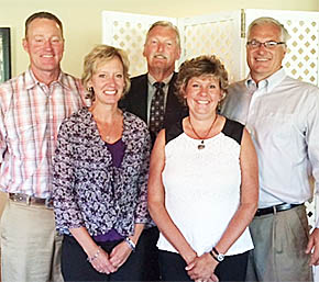 NEW AND RETIRING TRUSTEES -- Honored at a dinner Monday night were (l.-r.) new Boone County Health Center trustee Paul Groeteke and his wife, retiring trustee Janet Groeteke, new trustee Kim Beierman and retiring trustee Tim Kayton, shown with BCHC President and CEO Vic Lee, center.
