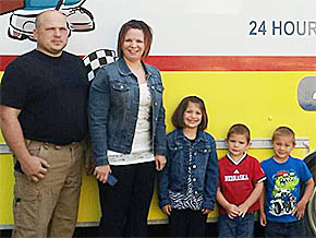 Mike and Tanya Sharp with their children (l.-r.) Dayna, Austin and Carter.