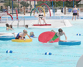 Local swimmers enjoy the pool Monday.