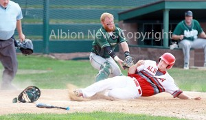 Keaton Henry slides home safely