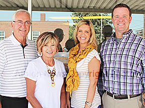 OWNERSHIP CHANGE -- Ralph and Debbie Schmadeke (l.-r.), Nikki Stephens and new owner Bryce Spann will be working together at Schmadeke, Inc. Insurance and Real Estate in Albion.