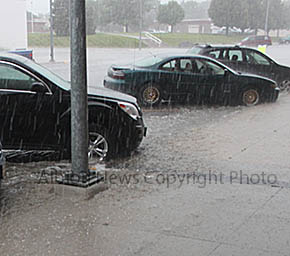Storm drainage filled the streets and went over the curbs in downtown Albion.