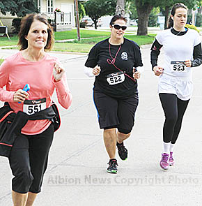 Runners in the Color Me A Cure benefit run last Saturday.