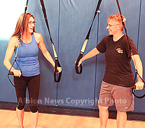 Instructor Trish Daniels assists Gina Geiser-Fousek with a new exercise.